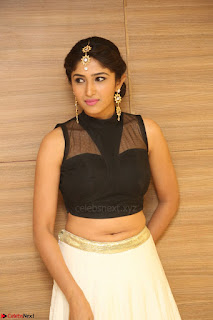 Roshni Prakash in a Sleeveless Crop Top and Long Cream Ethnic Skirt 074.JPG