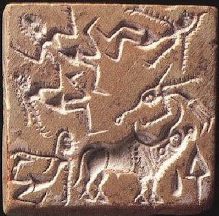 Impression of a Banawali seal from c.2300 – 1700 BCE, showing an acrobat leaping over a bull