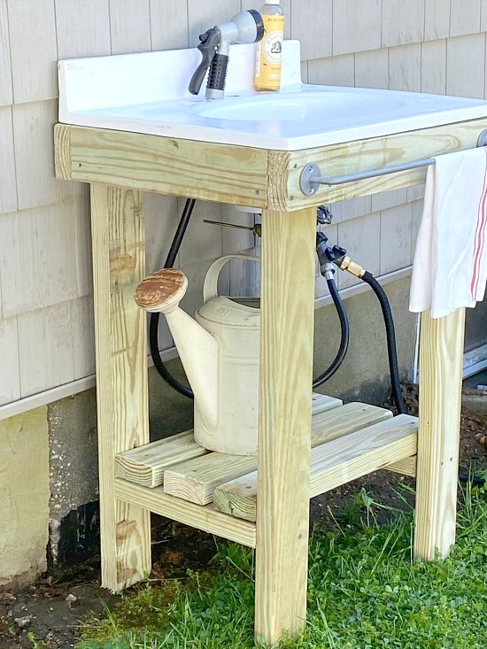 Outdoor sink using reclaimed white sink and pressure treated lumber