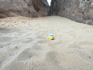 Yellow Van in sand on Landscape Arch trail
