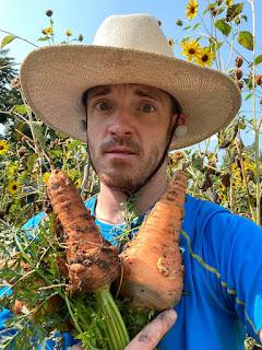 Farmer with Giant Carrots