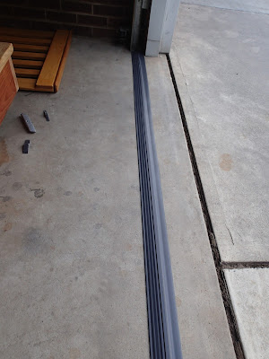 Install garage threshold