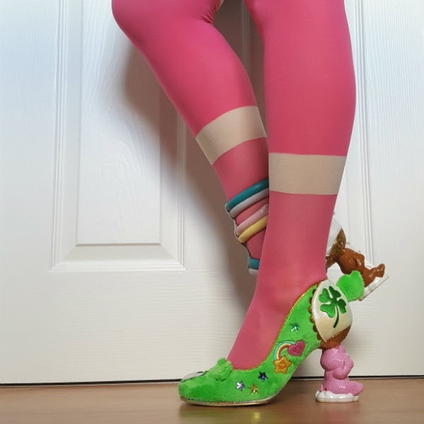 wearing pink tights with green furry court shoe with pink care bear shaped heel