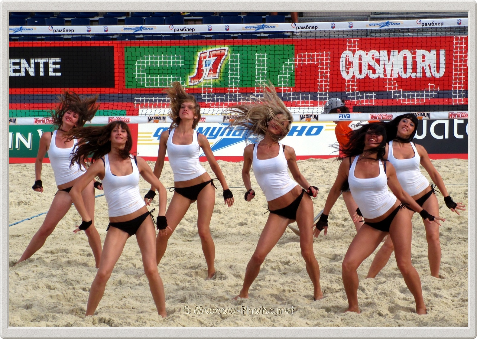 Beach Volley Dancing Girls In Black-White Suits