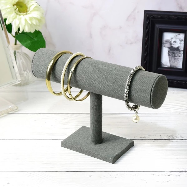 Gray linen Single T-Bar Jewelry Display holding four minimalist bangles