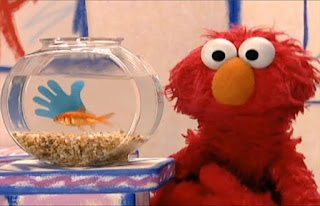 Dorothy is not alone her bowl, she has a blue hand in her bowl. Elmo's World Hands Dorothy's Question