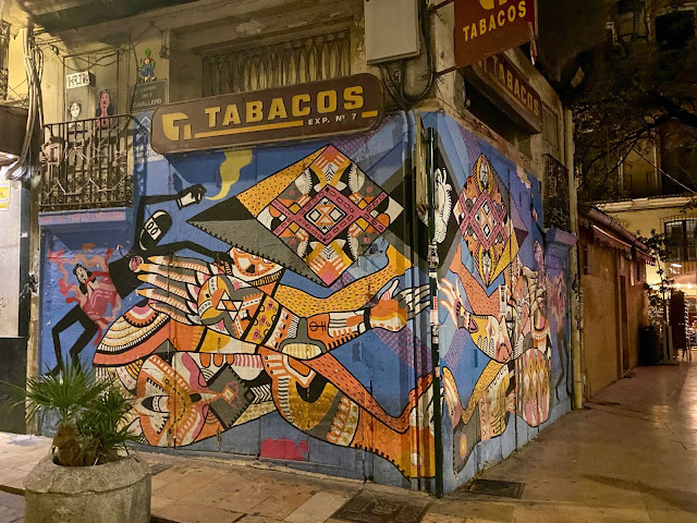 Street art at night in the old historic centre of Valencia, Spain