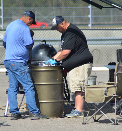 Heavy Smoke checking their ribs at the 2019 Smokin' With Smithfield National Barbecue Championship