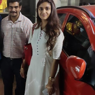 Keerthy Suresh in White Dress with Cute Smile with a Lucky Fan