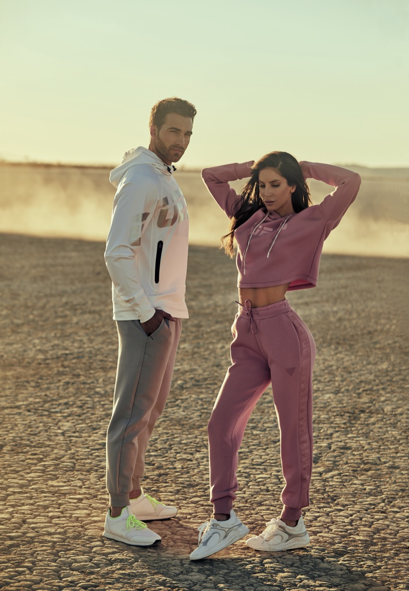 Jen Selter poses with Nic Palladino for Guess activewear spring 2021 campaign.