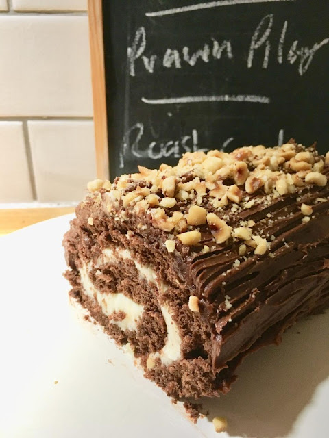 Chocolate yule log topped with nuts
