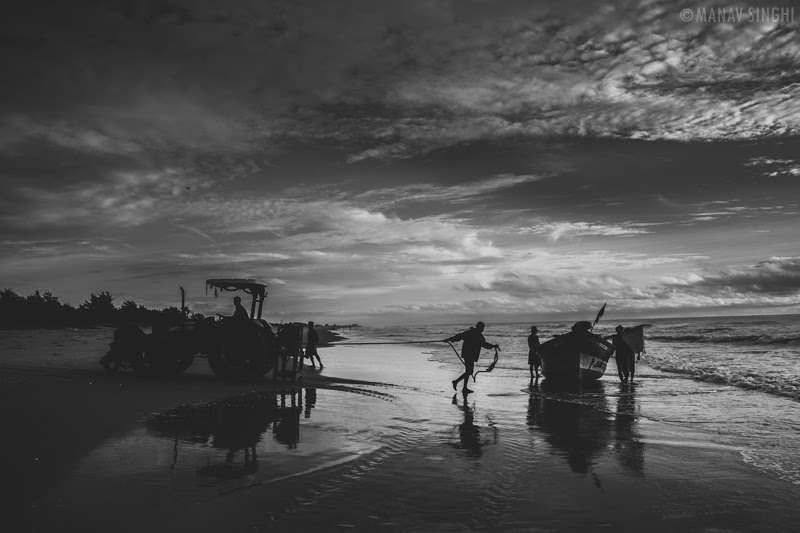 Fisherman bringing there boat back to shore at Fisherman Area near Le Pondy Beach Resort, Pondicherry- 31-Oct-2019
