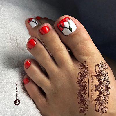 unhas dos pés decoradas com vermelho