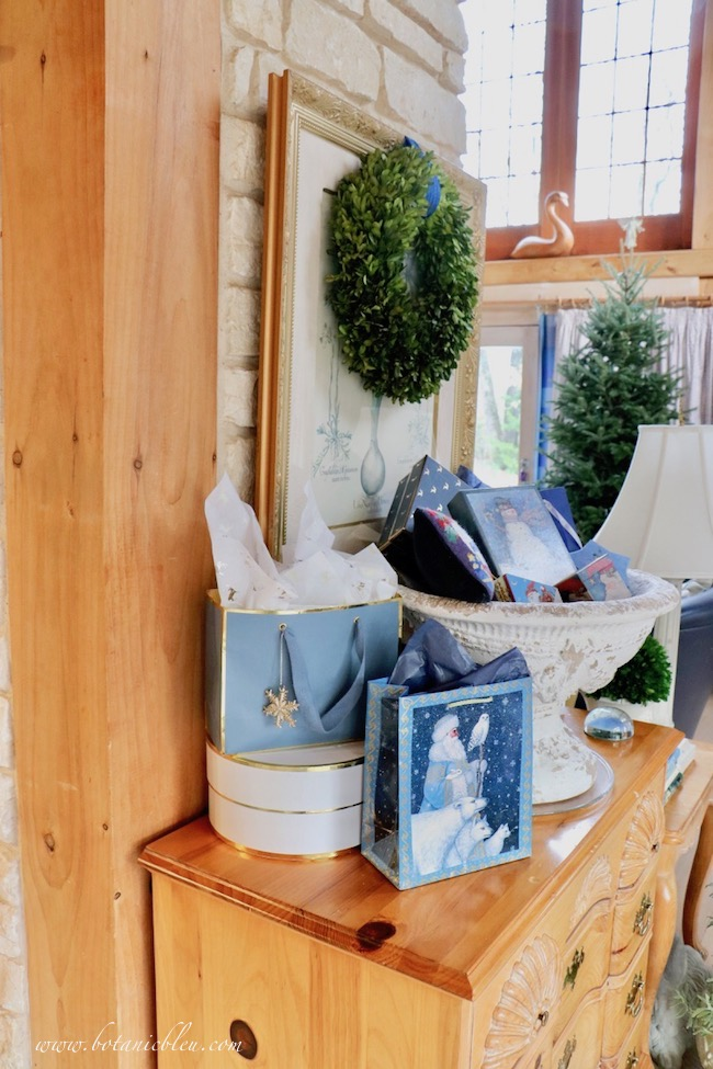 French country blue Christmas presents angled so the display is beautiful from every view