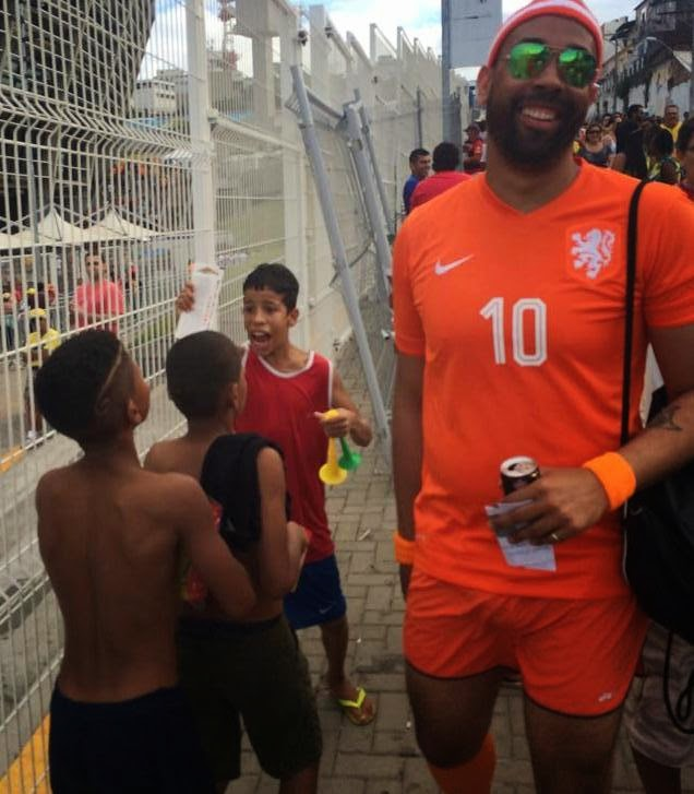 25 Photos Of People Who Will Inspire You - This man had two extra tickets to the Spain-Holland game. Instead of selling them, he gave them to this very excited young boy.