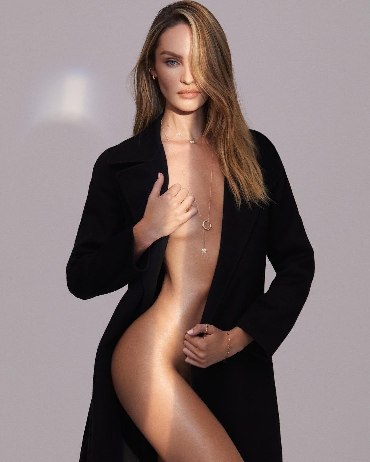 Candice Swanepoel goes topless for Logan Hollowell Jewelry