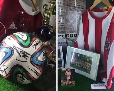 two images: a signed football, and a sheffield wednesday shirt alongside a newspaper clipping and framed image of the team