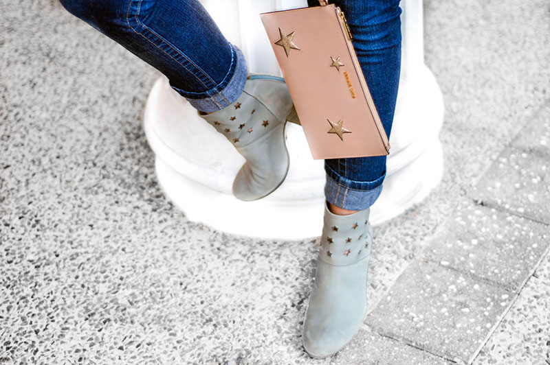 grey ankle boots with cut out stars and michael kors blush pink clutch bag with silver stars