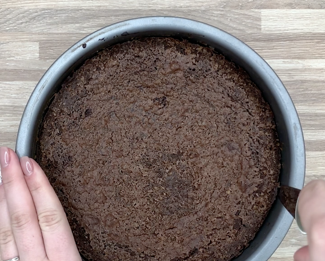 passing a knife through the edges of the brownie cake