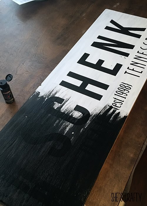 Painted wood sign with last name using vinyl as a stencil