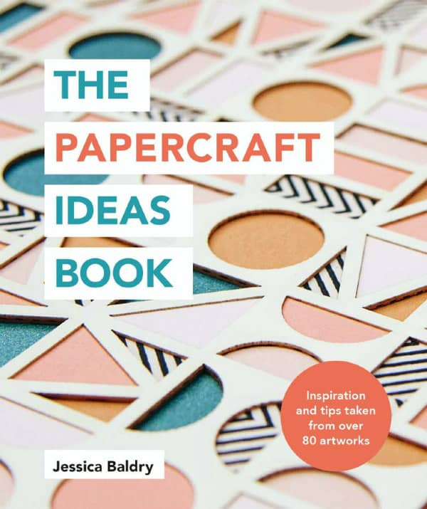 layered geometric paper art on book cover