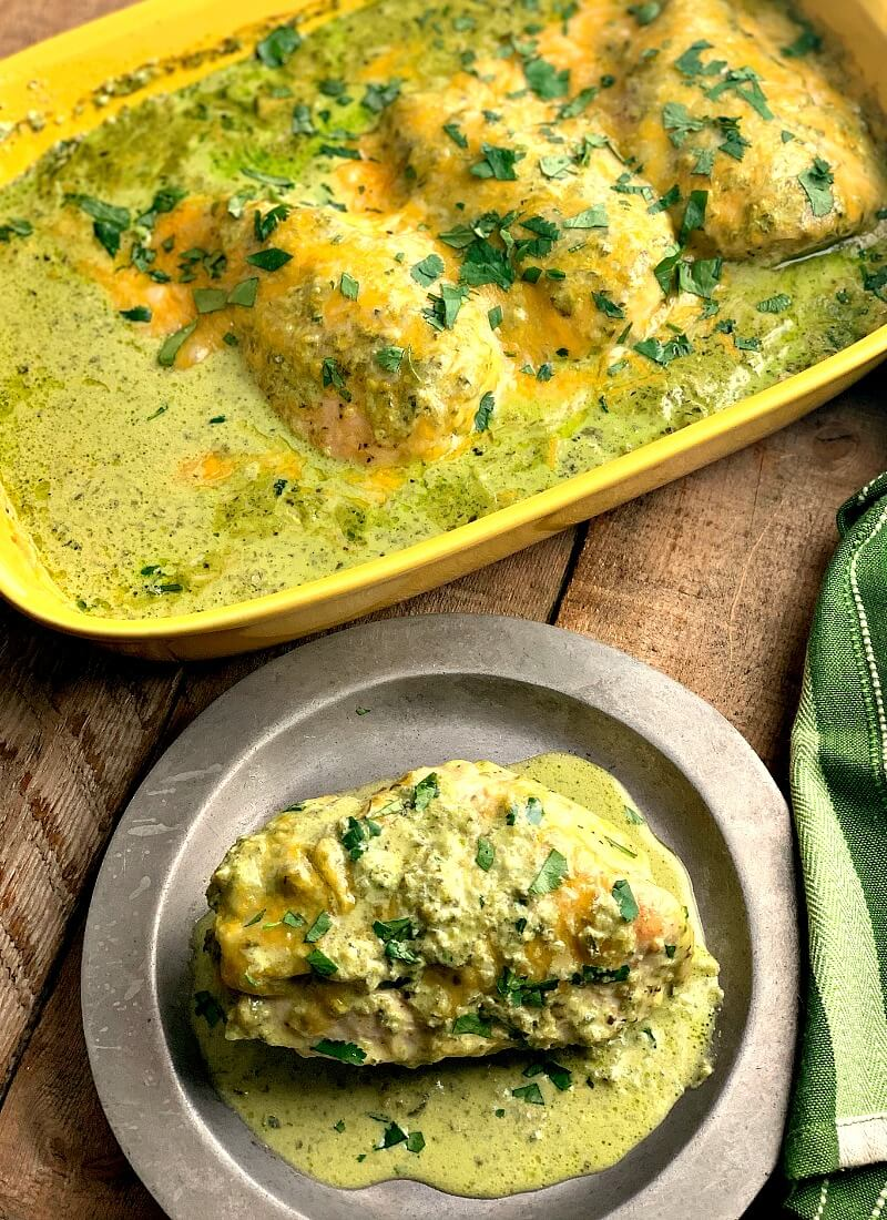 Baked Green Chile Chicken - This Baked Green Chili Chicken recipe is an easy and delicious low carb and keto-friendly dinner filled with spice, cheese, and a creamy green chili sauce. #Mexican #chicken #lowcarb #keto #glutenfree #chickenbreast #chickenthighs | bobbiskozykitchen.com