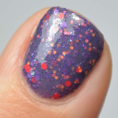 purple nail polish with purple and red glitter swatch
