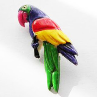 Bright parrot brooch in plastic