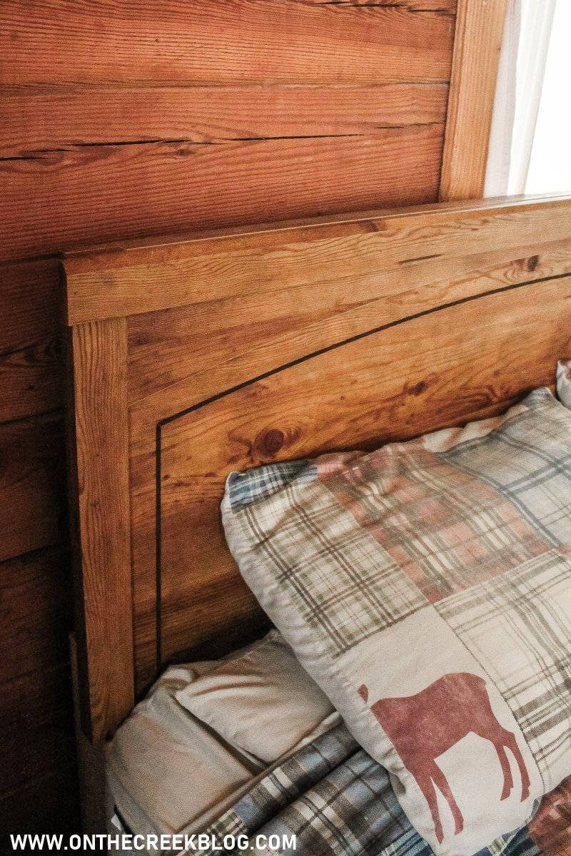 Our current headboard!  I'm looking for rustic inspiration to give this one a makeover! | On The Creek Blog