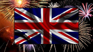 Image of the British flag in front of a sky with fireworks