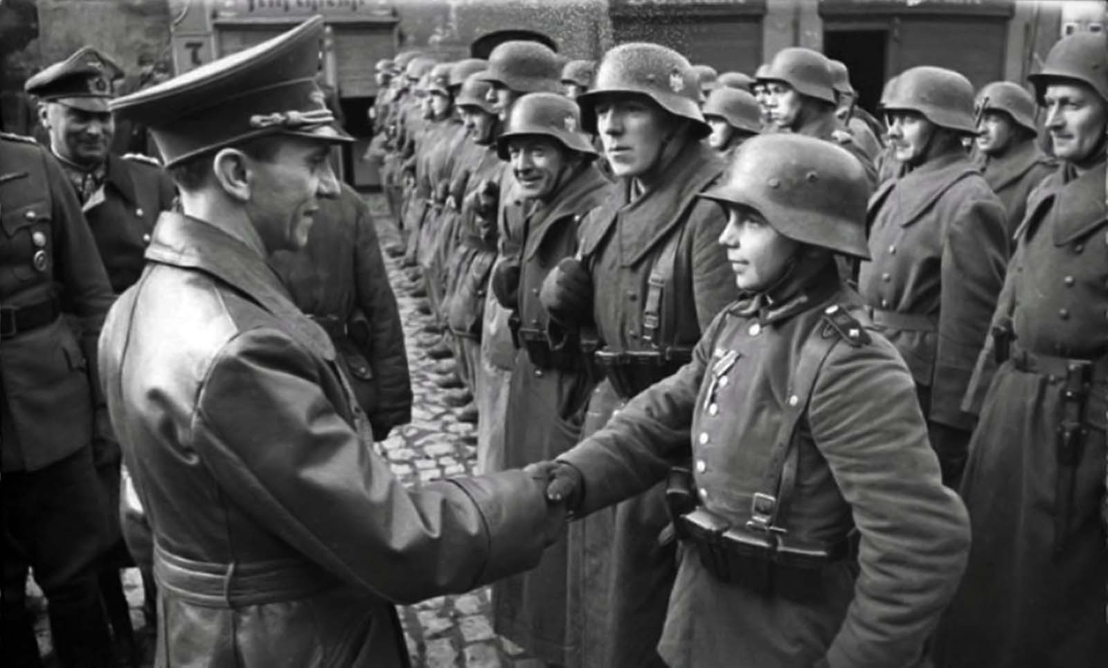 Joseph Goebbels awards the 16-year old Hitler Youth member Willi Hübner the Iron Cross for the defense of Lauban. March 9, 1945.