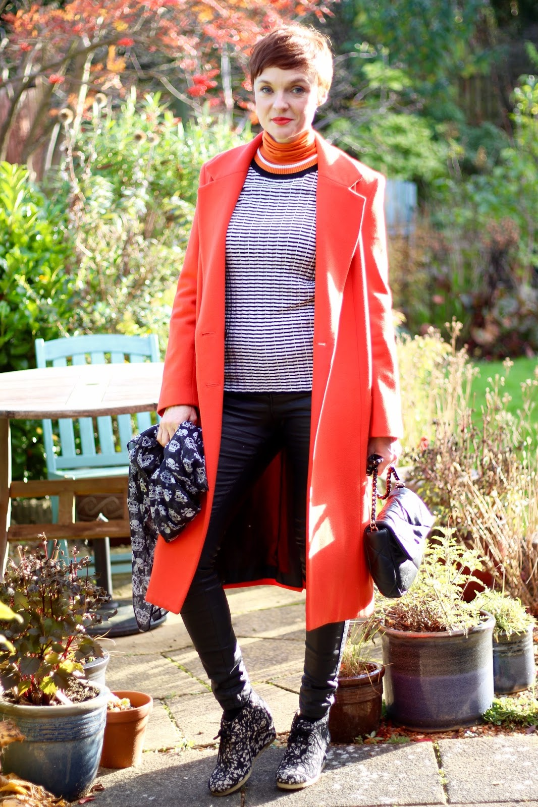 Orange Coat, Black Coated Jeans & Striped Jumper | Fake Fabulous