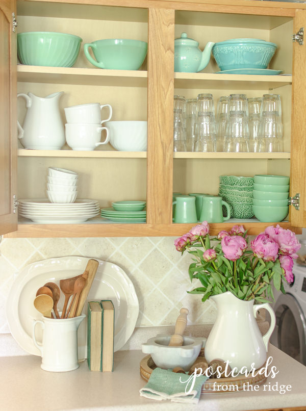 vintage jadeite and white dishes in cabinet with Duck Brand Smooth Top EasyLiner