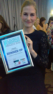 Founder Katie with award