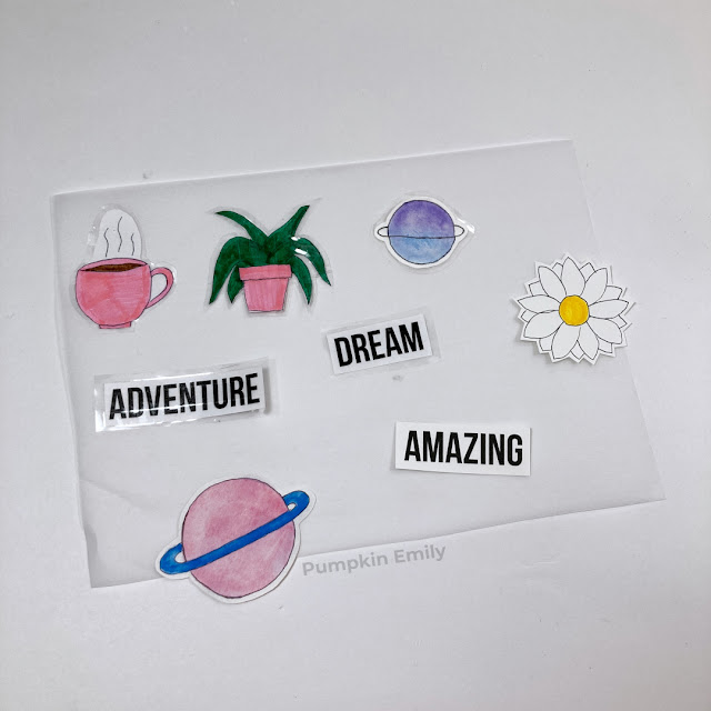 DIY stickers made with tape and sticker paper laying on parchment paper.