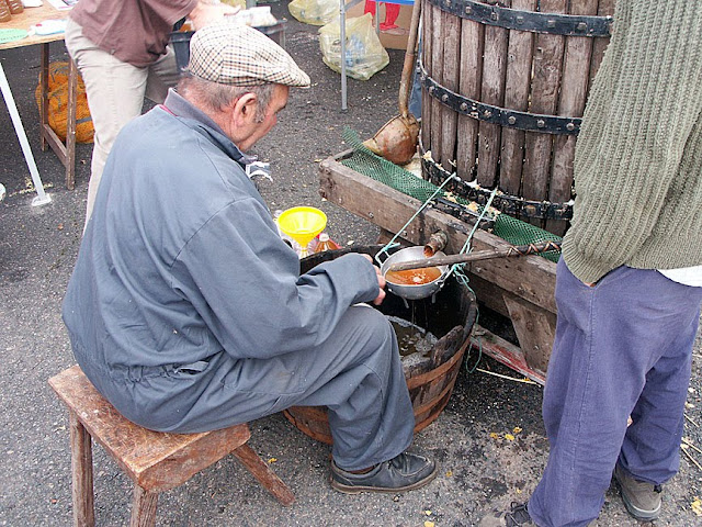 Making apple juice at a food fair, Indre et Loire, France. Photo by Loire Valley Time Travel.