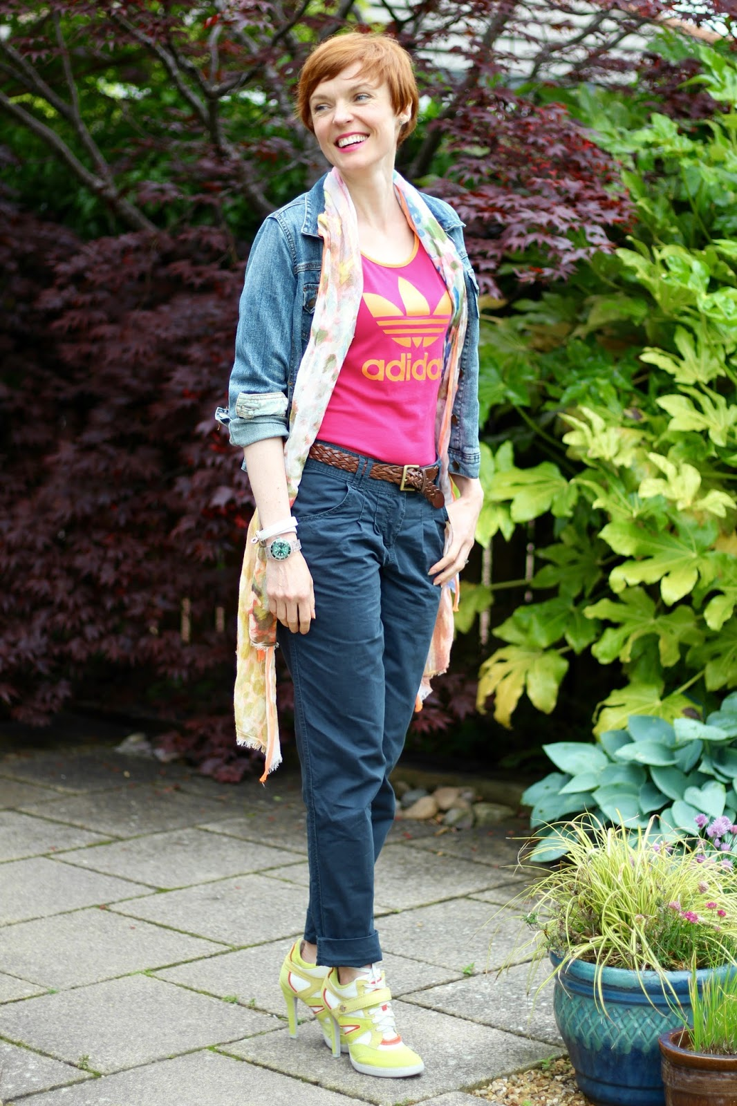 Fake Fabulous | Sports chic. Adidas vest top, Denim Jacket, navy chinos, stiletto trainers, pink and orange