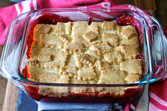 This Cherry Cobbler with a Sugar Cookie Crust is so delicious served warm and topped with vanilla ice cream.