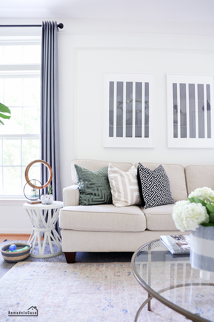 sofa and gray curtains and plain wall art in blue