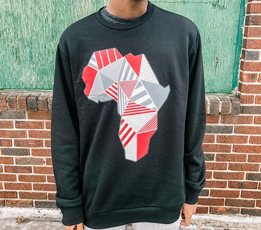 a young black man wearing a black sweatshirt