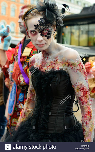 Halloween costume idea: steampunk zombie bride in adhesive lace mask by Laced And Waisted. Half mask, black corset, skirt, feather fascinator/hair piece, special fx makeup.