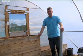 Calum in the Polytunnel