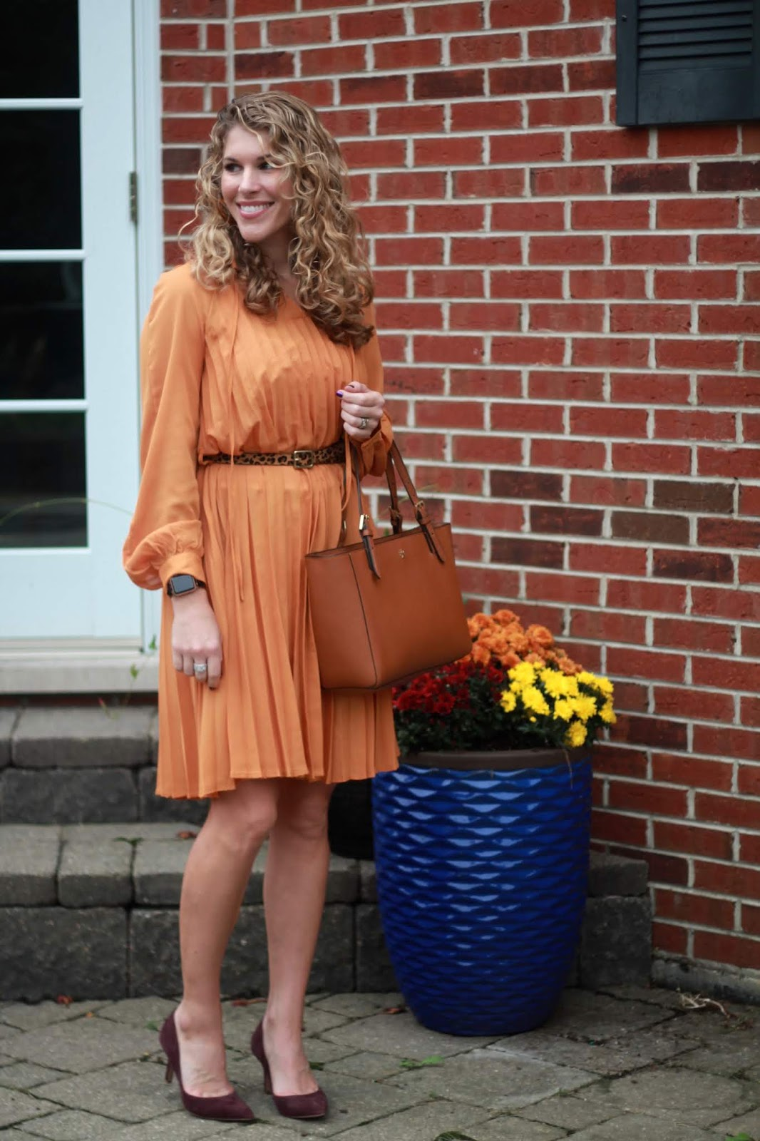 yellow pleated dress, burgundy heels, Tory Burch tote, leopard belt,