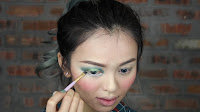 Sparkling Green New Year's Eve make up -With liner brush, apply Fringe on the outer lower lash line.