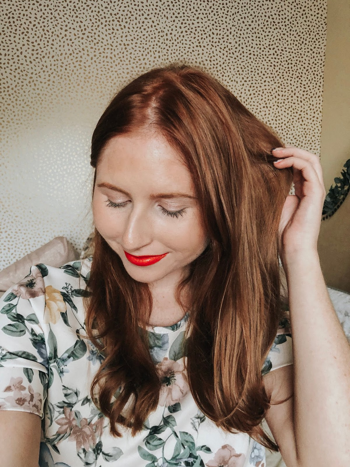 Best Drugstore Lipsticks for Fair Skin: Summer Edition NYX Liquid Suede Cream Matte Lipstick range. Amanda Burrows of Affordable by Amanda shares her beauty post covering drugstore lipsticks from NYX. She is wearing the orange color orange county.