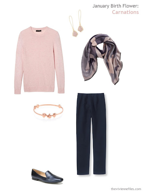 wearing a carnation pink sweater with navy
