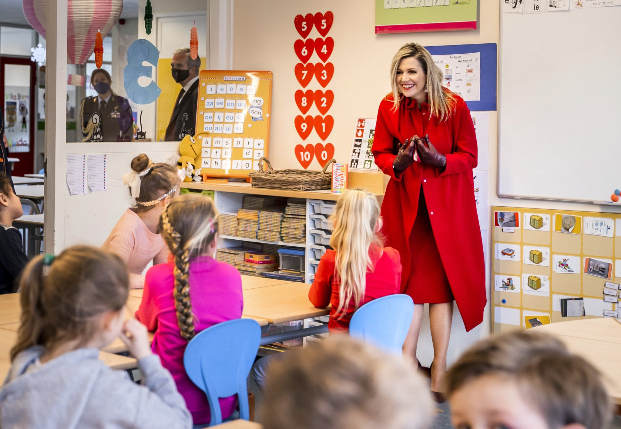 Queen Maxima in Red for a School visit