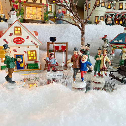 A Victorian Christmas Village Mantle Display