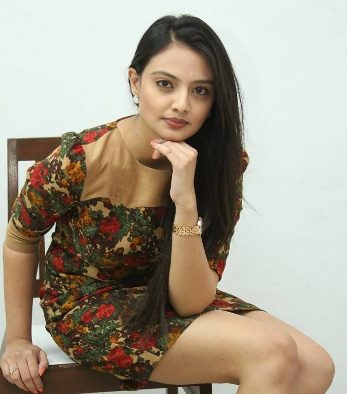 Nikitha Narayan Legs Thighs Show Stills In Green Mini Skirt At Album Launch