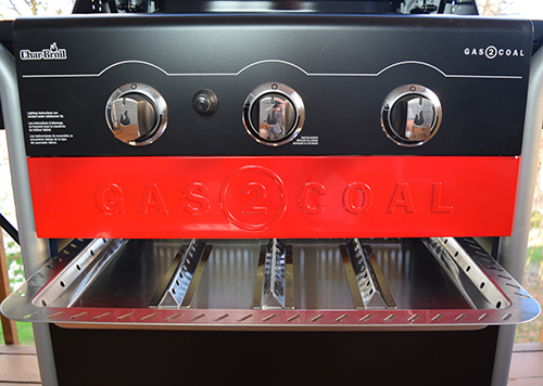 Char-Broil gas to coal combination grill contains space for storing of grilling tools